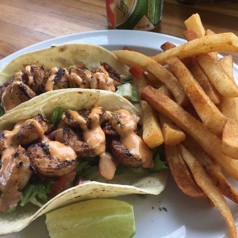 SHRIMP TACOS. YES PLEASE. - With a side of our signature seasoned fries. VIEW FULL MENU