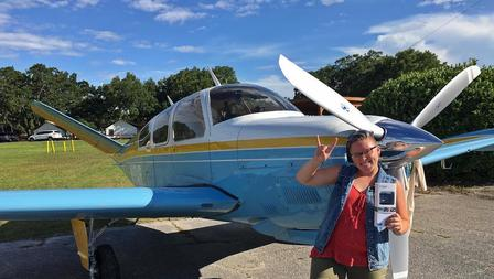Photo of Patty Fritz after winning the Millennial Wings first spot landing contest.  Patty took home a new GoPro Hero Plus Provided by the Banyan Pilot Shop!