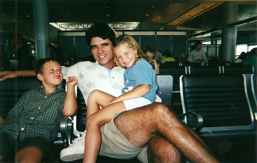Me, my dad, and my big brother in the airport on the way to one of our many trips to Brazil.