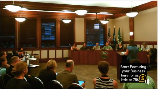 A live stream still of a City council meeting in the dalles