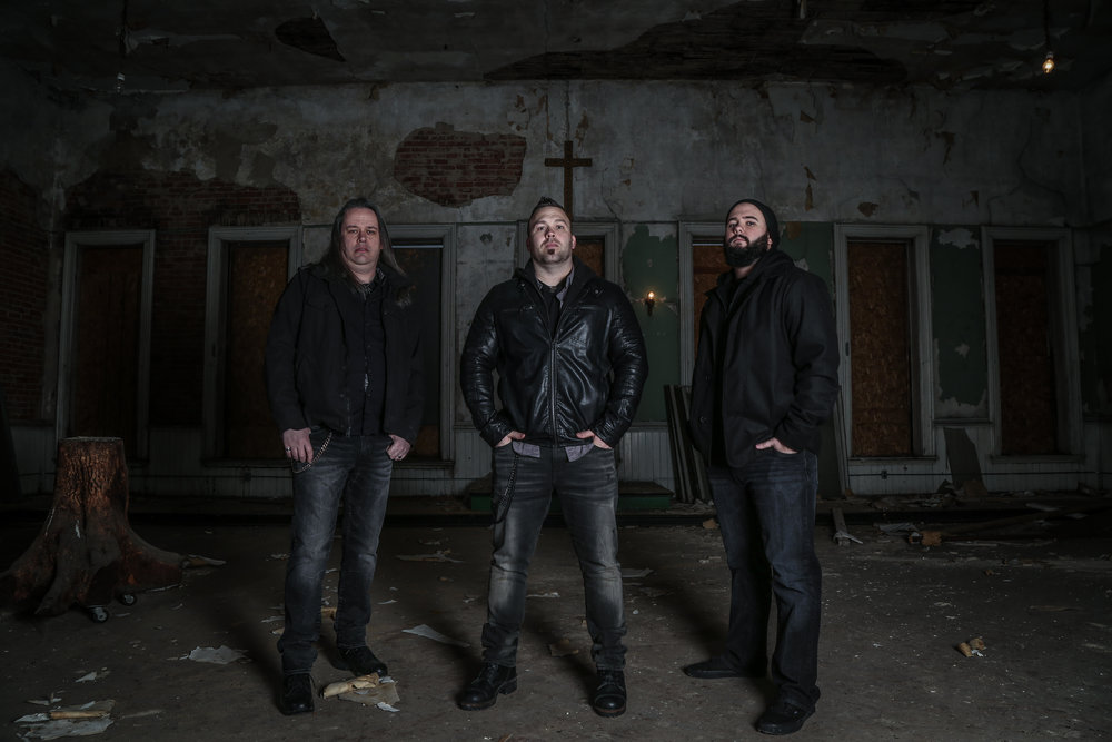 From left to right: guitarist Tony Phillips, vocalist Scott Artis, bassist Josh Quillen