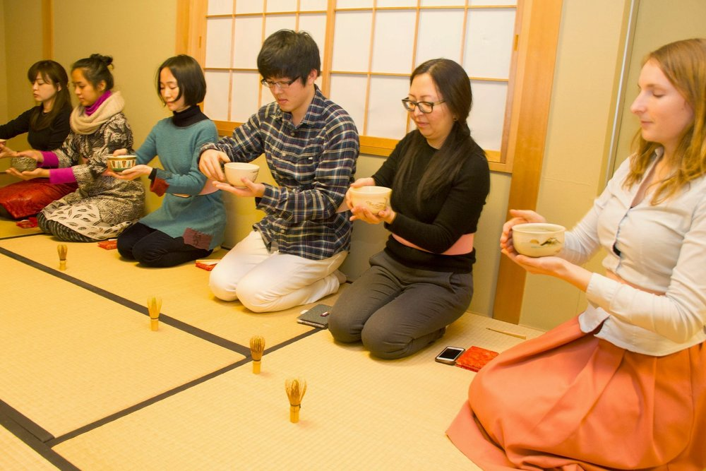 Students learning the traditional tea ceremony.