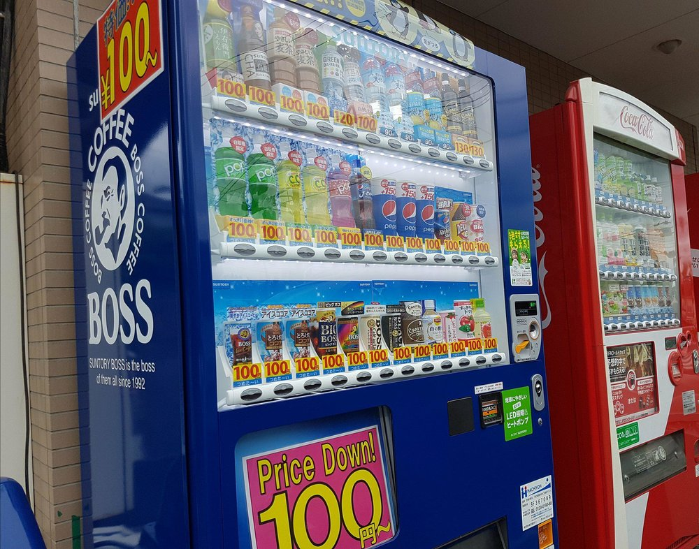 Vending machine drinks at a special 'student price', only 100 yen; water for 90 yen.
