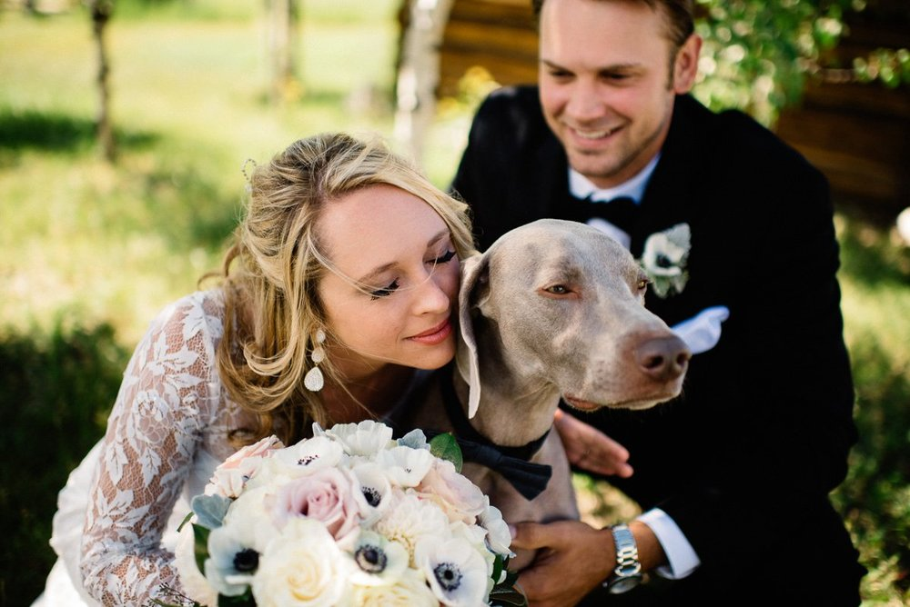 couple with dog destination wedding photography at strawberry creek ranch in granby colorado