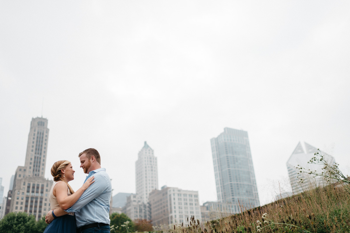 destination Engagement photography at  Lurie Garden in Chicago  with city scape