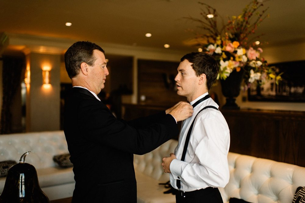 groom getting ready at white house hotel. biloxi mississippi wedding photography