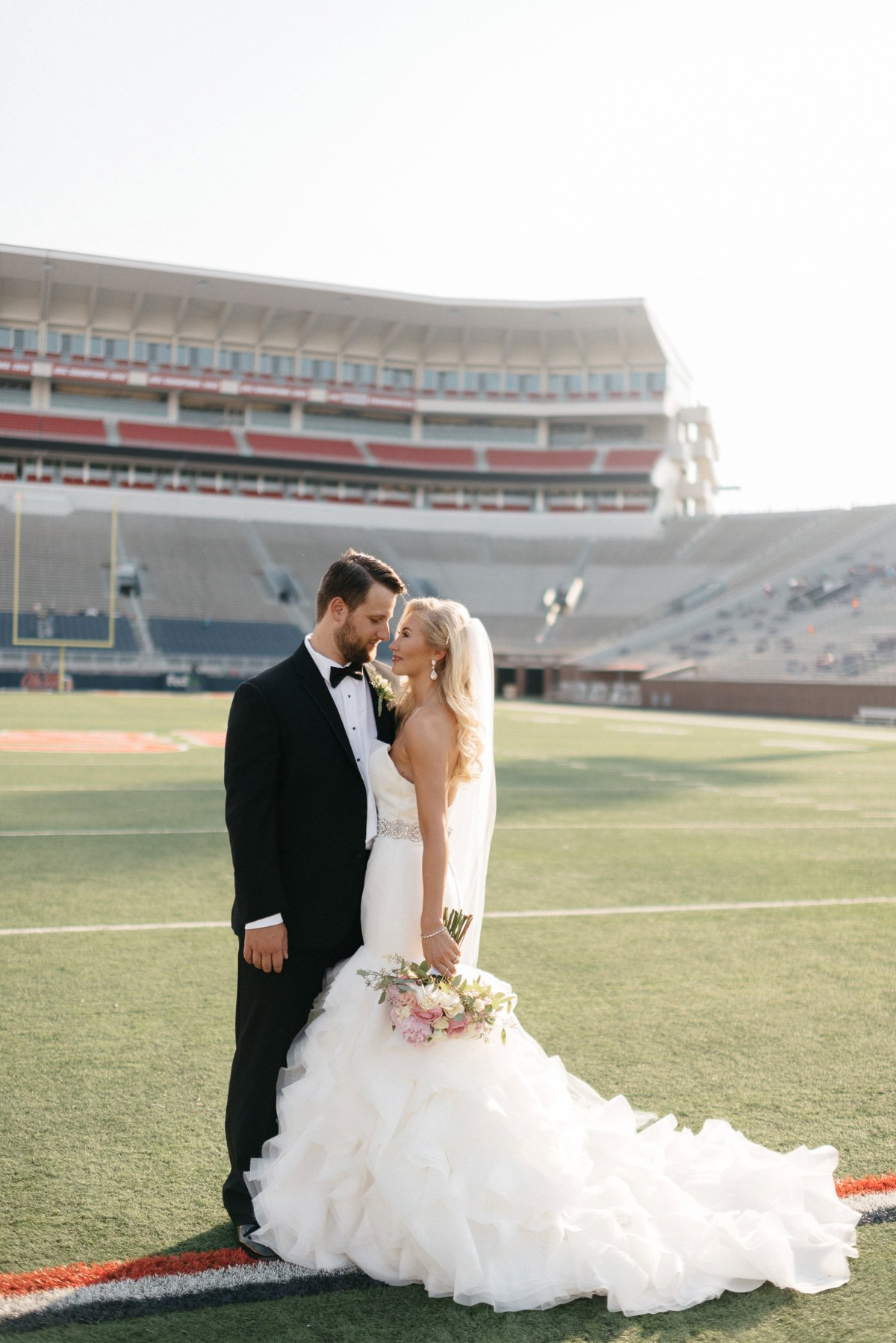 bride and groom wedding photography at  vaught hemingway  football stadium on ole miss campus