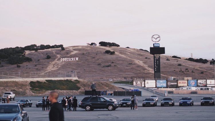 I couldn't sleep the whole night since I have been very anxious about the event.  We all woke up at 7 am to quickly get ready for the big day.  As I was rolling into Laguna Seca, I had a moment feeling that I have been here before.  Of course, I knew it was my first time, but it was a powerful experience of déjà vu from my GrandTurismo gaming days since the PS1 era.  Being at Laguna Seca in person was a remarkable and unforgettable experience.  The track is very spacious and I've seen nothing like this back home. And here is a pit garage I rented for my car and equipments.
