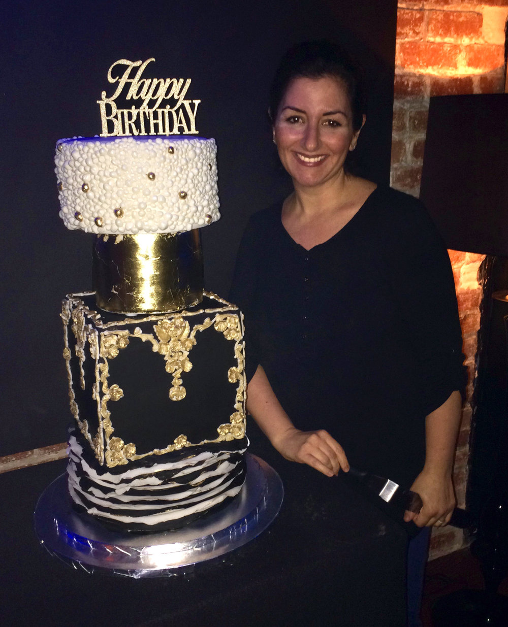 Arlette with the cake she created for Ayesha Curry's birthday bash in San Francisco in 2016.