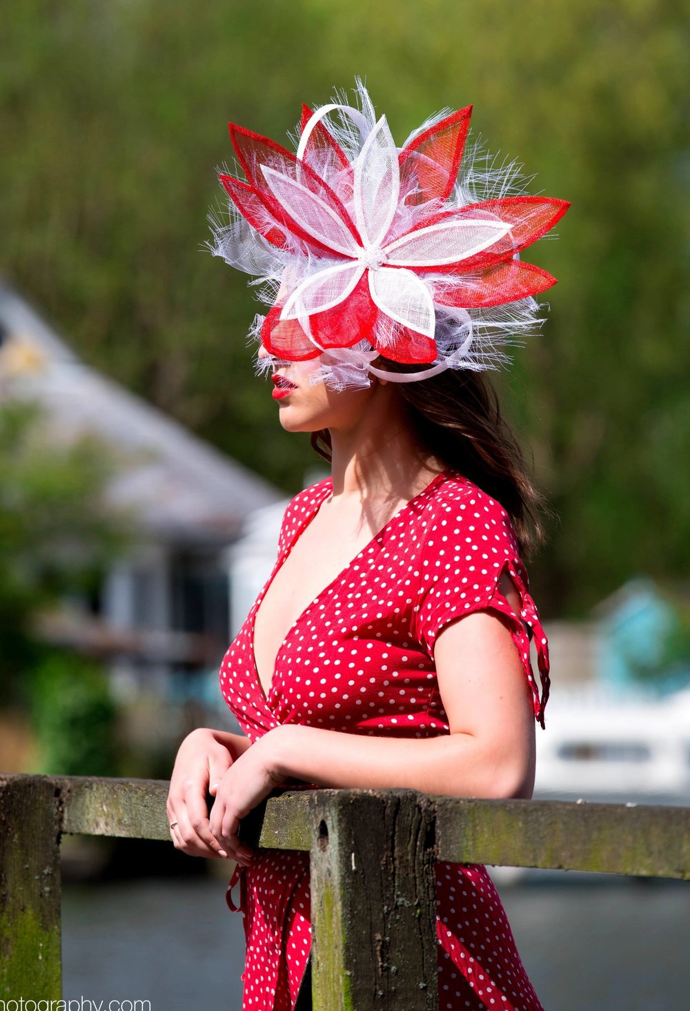 red and white flower fascinator