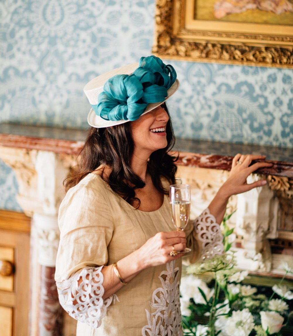 cream and teal wedding hat