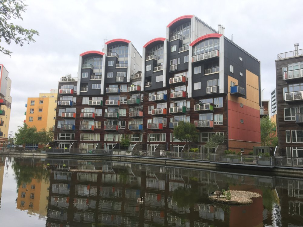 Large residential building with difficult access (Lake) for the renewing of Trespa Panels and maintenance of timber cladding