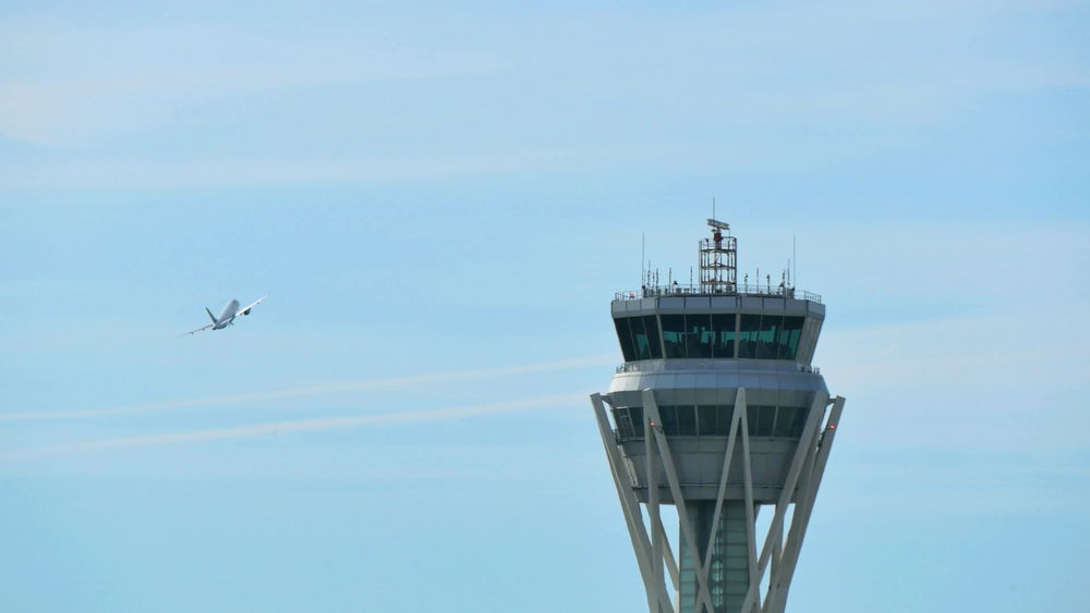 barcelona-airport-radar-control-tower-air-traffic-control-tower-at-barcelona-airport-with-flying-plane-in-sky-airport-control-tower-at-full-capacity-radar-control-tower-with-an-airplane-across-the-sky_njb1qhgge__F00.png