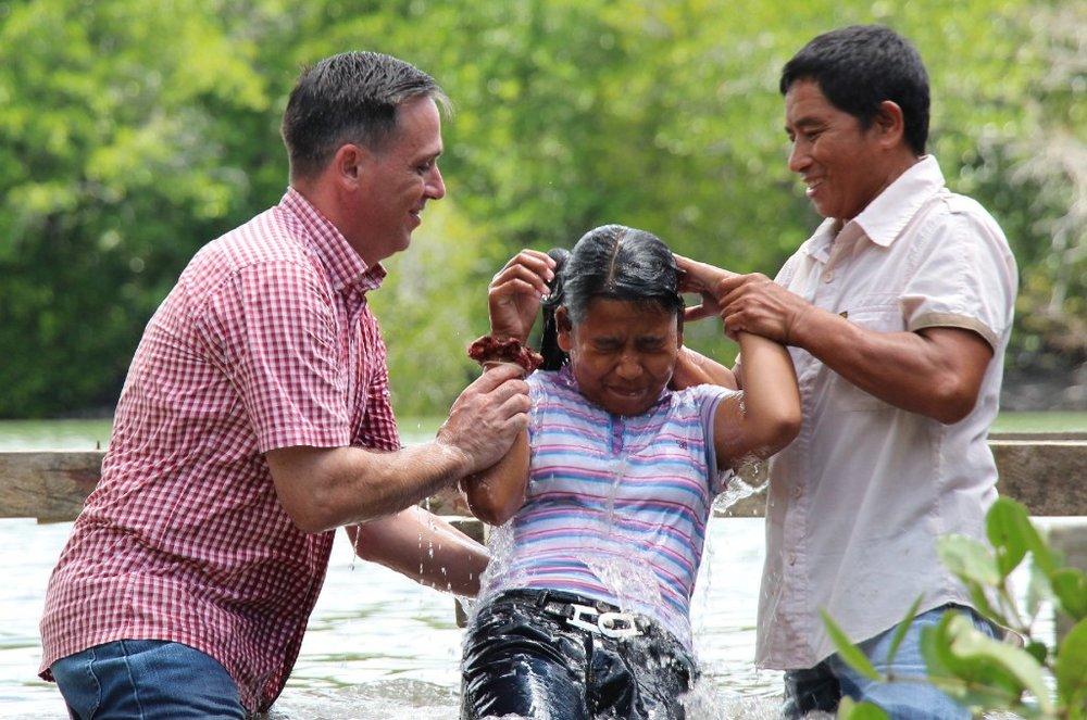 Edmund baptising his daughter