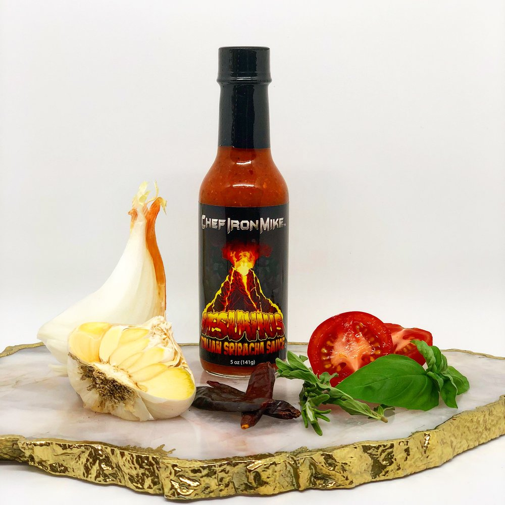 "VESUVIUS    ITALIAN SRIRACHA SAUCE   BE CAREFUL WHEN YOU OPEN UP THIS BOTTLE AND AWAKEN THIS VOLCANIC HOT SAUCE. IT'S A COMBINATION OF RED SERRANO AND CALABRIAN PEPPERS, INFUSED WITH GARLIC, ONIONS AND ITALIAN HERBS. THIS ITALIAN HOT SAUCE IS ONE OF A KIND AND PHENOMENAL ON PIZZA, PASTA, MEATBALLS, SAUSAGE AND PEPPERS, OR ANY ITALIAN FAVORITE TO TAKE YOUR FRA DIABLO EXPERIENCE TO A WHOLE NEW LEVEL.  ""MANGIARE"""