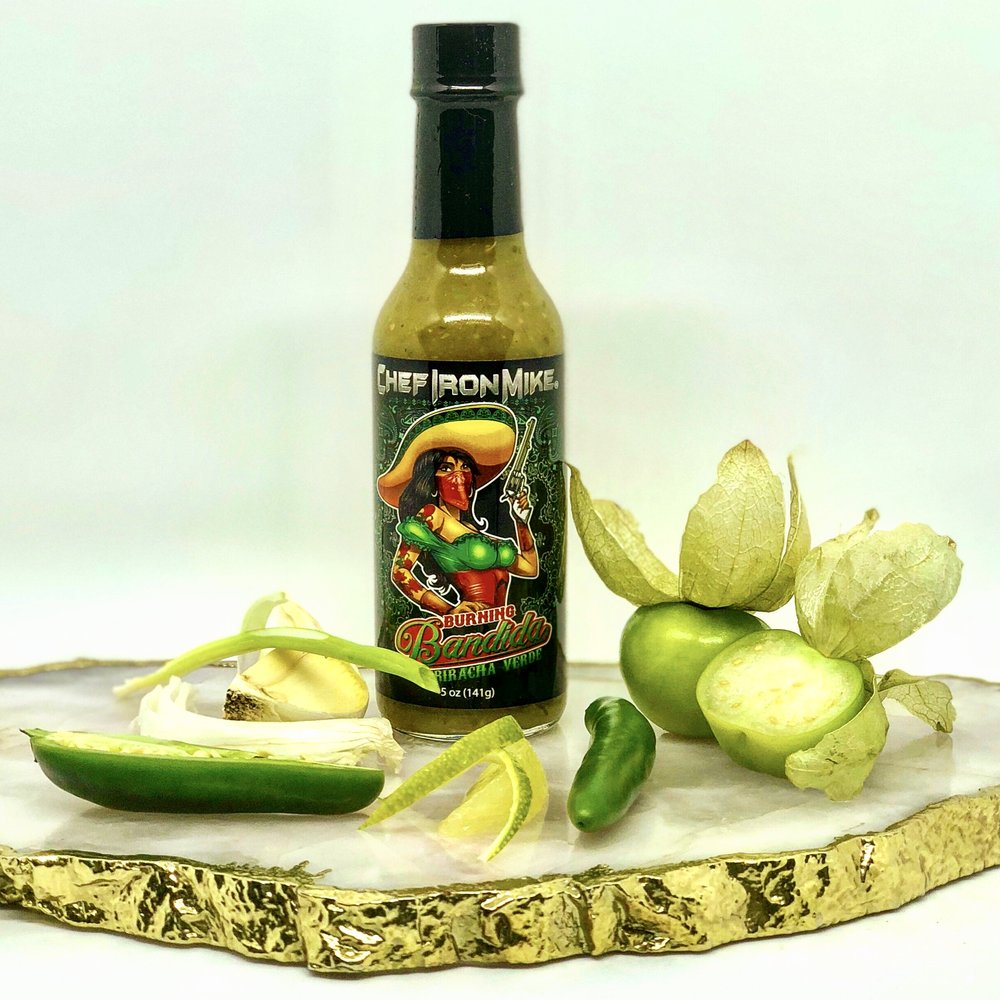 BURNING BANDIDA    SRIRICHA VERDE SAUCE   BE READY WHEN THIS SMOKING HOT BABE COMES ROLLING THROUGH YOUR TOWN. THIS IRRESISTIBLE HOT SAUCE IS A MINGLING OF JALAPENO & SERRANO PEPPERS, WITH TOMATILLOS, CILANTRO, GARLIC & ONION. SHOOT THIS SAUCE ALL OVER YOUR TACOS, QUESADILLAS, ENCHILADAS, BURRITO, OR ANY FAVORITE MEXICAN OR SPANISH STYLE DISH.  CALIENTE!