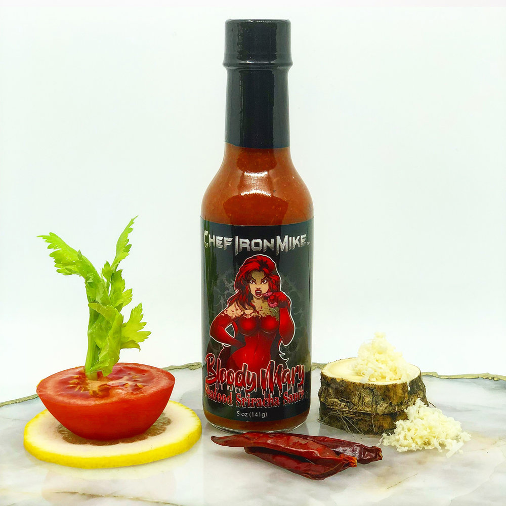 BLOODY MARY    SEAFOOD SRIRACHA SAUCE   BEWARE WHEN OPENING THIS BOTTLE!! MARY IS BACK AND SHE'S A HOT MESS, DARING YOU TO SQUEEZE HER ALL OVER YOUR FAVORITE SEAFOOD. THIS BLOODY MARY FLAVORED HOT SAUCE IS A BLEND OF CAYENNE AND ARBOL PEPPERS, HORSERADISH, CELERY AND LEMON. IT'S SPECTACULAR ON SHRIMP OR CRAB COCKTAIL, RAW OYSTERS & CLAMS, FRIED SEAFOOD OR EVEN YOUR OWN BLOODY MARY COCKTAIL.  TAKE A BITE!