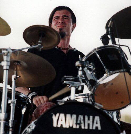 "Vance - Drums/PercussionVance White ""Blanco"" has been playing since the age of 5 when he sat down behind the kit of his father's band ""White Heat"" and saw his reflection in those old-school Remo silver dot drum heads. He played all throughout his school years in Charleston SC and was involved in every musical venture the system had to offer (marching center snare, principal jazz kit, orchestra 1st chair percussion). He played with bands ""Anorexic Mosquito"", ""SRA"", and later with ""The Cool"" which spanned genres from Punk to Metal to Classic Rock. While attending College of Charleston for Classical Percussion he's played Tympani for the Charleston Symphony Orchestra, The Charleston Community Orchestra, and was also a percussionist for hire for various area churches and other organizations. He was a jazz drummer for the College of Charleston pep band and a session drummer for many of the areas recording studios. His main influences are David Weckl (Chic Corea, Dave Weckl Band) and Tim ""Herb"" Alexander (Primus). Although Vance listens to a variety of music, his all-time favorite band is Pink Floyd. On any given day you may catch him listening to Jazz, Classical, Metal, or old school Funk. Despite the wide variety of influence his style is an established Funk/Rock Fusion."