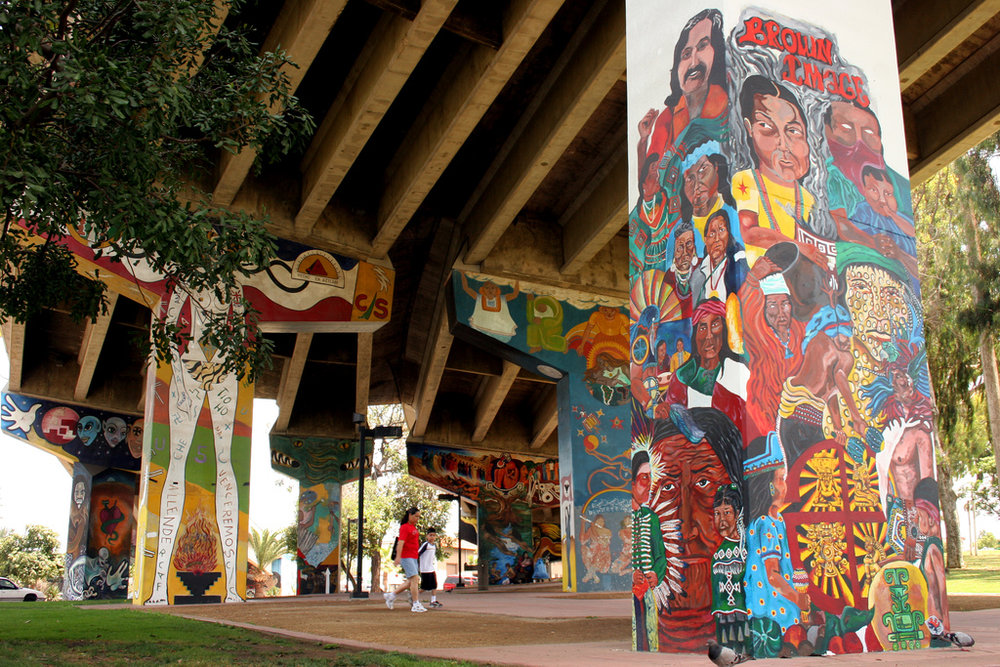 Chicano Park in San Diego is an example of a tactical intervention in an elevated highway. This murals were made by Mexican-American Activists during the occupation of the space in the 1960s. Description: Chicano Park Murals. Author: Kellinahandbasket. August 10 2006, San Diego, CA. Registered under a Creative Commons 2.0 license. Available in Flickr.
