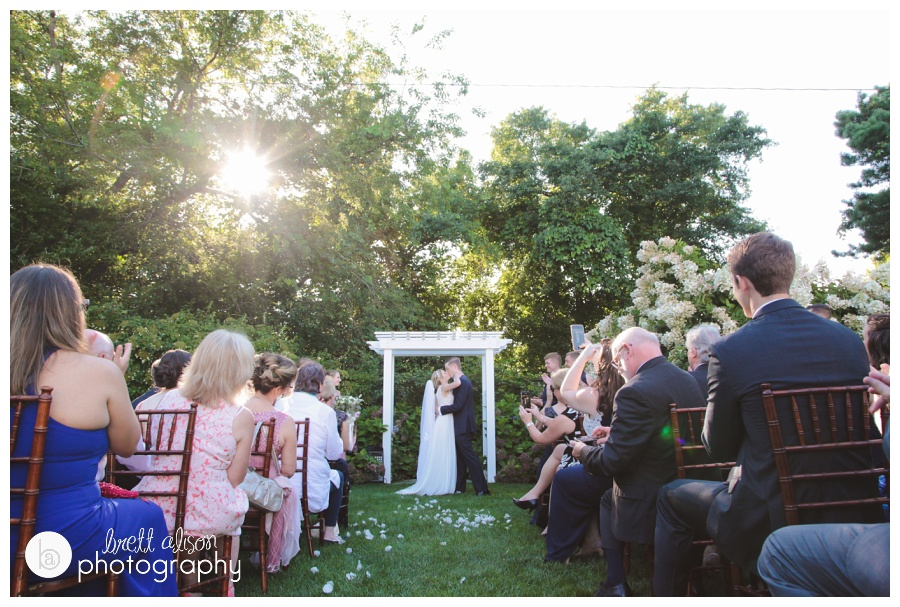 This is one of my favorite moments from Hillary and Andrew's wedding at the Dennis Inn. Just love seeing this from the guests' view, as well as the sun peeking through the trees.