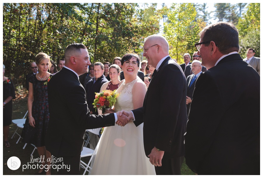 This is a moment that I always try to capture - the dad meeting the groom at the end of the aisle. In this instance, Shannon is looking up at her dad and her face is just so filled with joy!