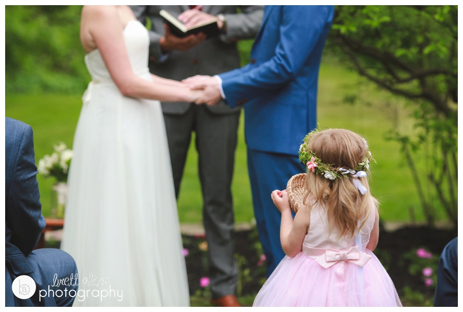 The flower girl at this backyard wedding had a very important job of helping pass around the rings for all the guests to say their well-wishes over. I loved this little moment where she was just so mesmerized with the ceremony that she stopped in the middle of the aisle.