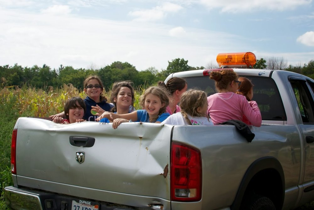 visitors in the back of the truck.jpg