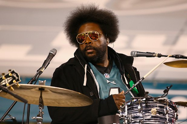 Questlove  - Music   Ahmir Khalib Thompson  is a percussionist, multi-instrumentalist, DJ, music journalist, record producer, and occasional actor. He is best known as the drummer and joint frontman (with Black Thought) for the Grammy Award-winning band The Roots.