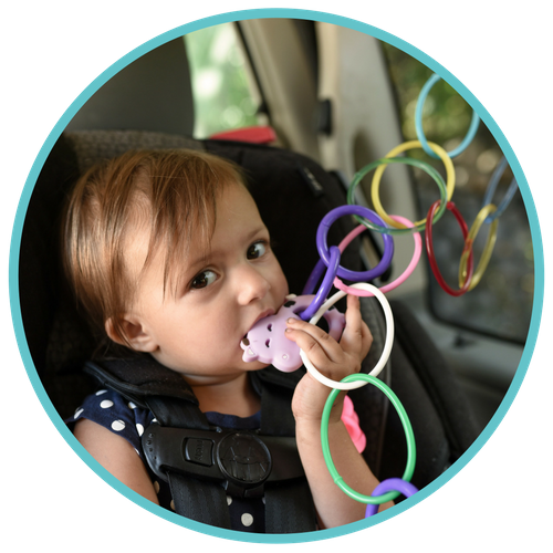 Child in Car with Teether Drop Stopper