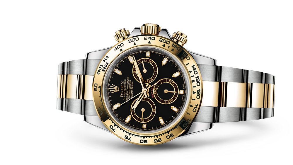 """COSMOGRAPH DAYTONA<br><span class=""""watch-des"""">Oyster, 40 mm, Oystersteel and yellow gold</span>"""