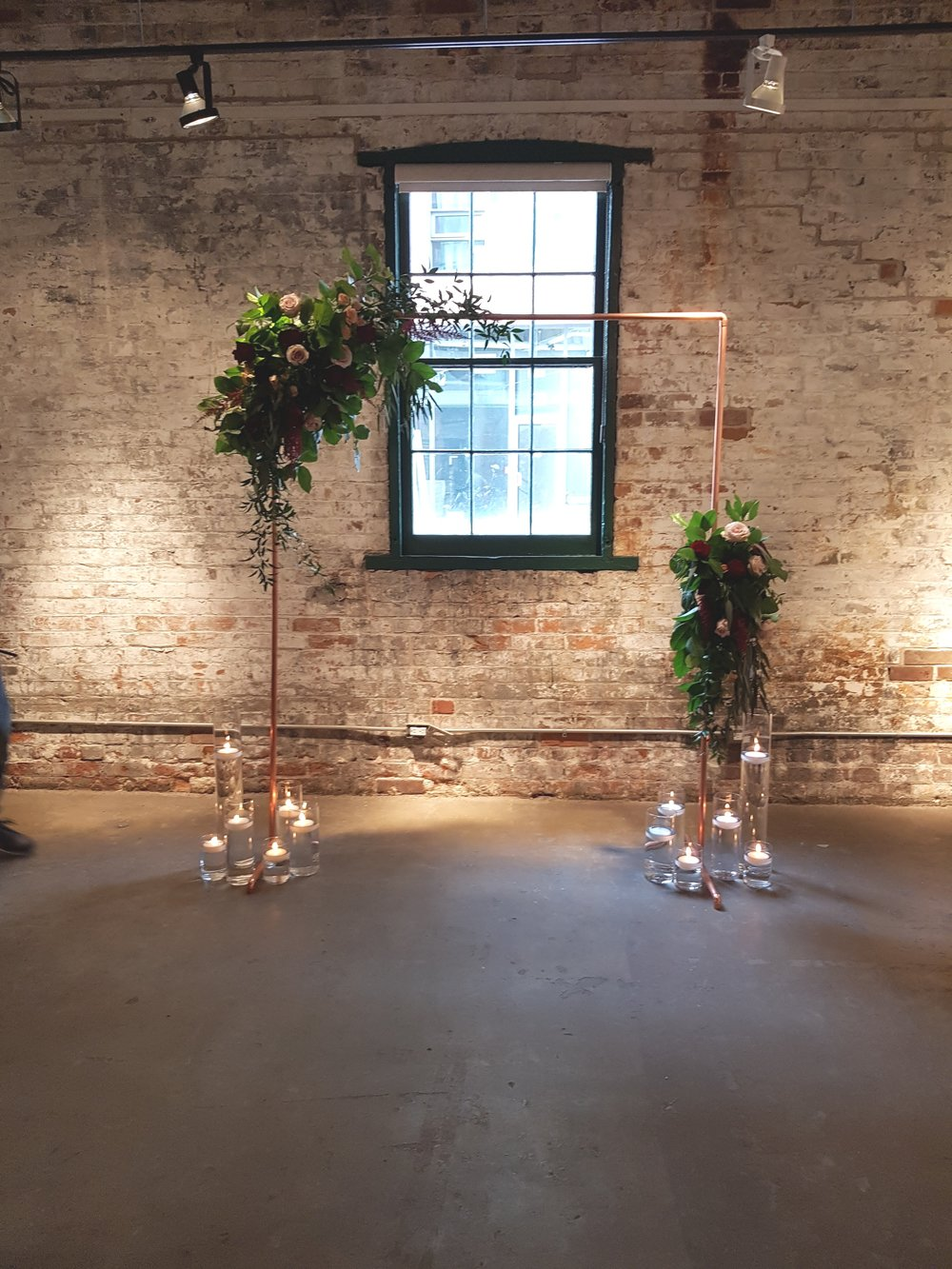 Copper Frame - $100   6.5' H x 5' W  (Flowers and decor not included)