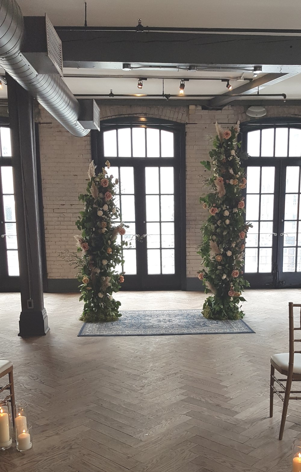 Asymmetrical Floral Arch - $450   Made with permanent and dried florals and greenery. Measurements: Approx. 7' H and 5' H