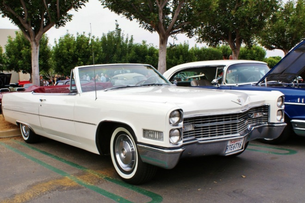 1966 Cadillac Convertible - One of our most popular wedding rentals, this '66 Cadillac is guaranteed to stand out. It's big, Ready to be booked for your wedding!