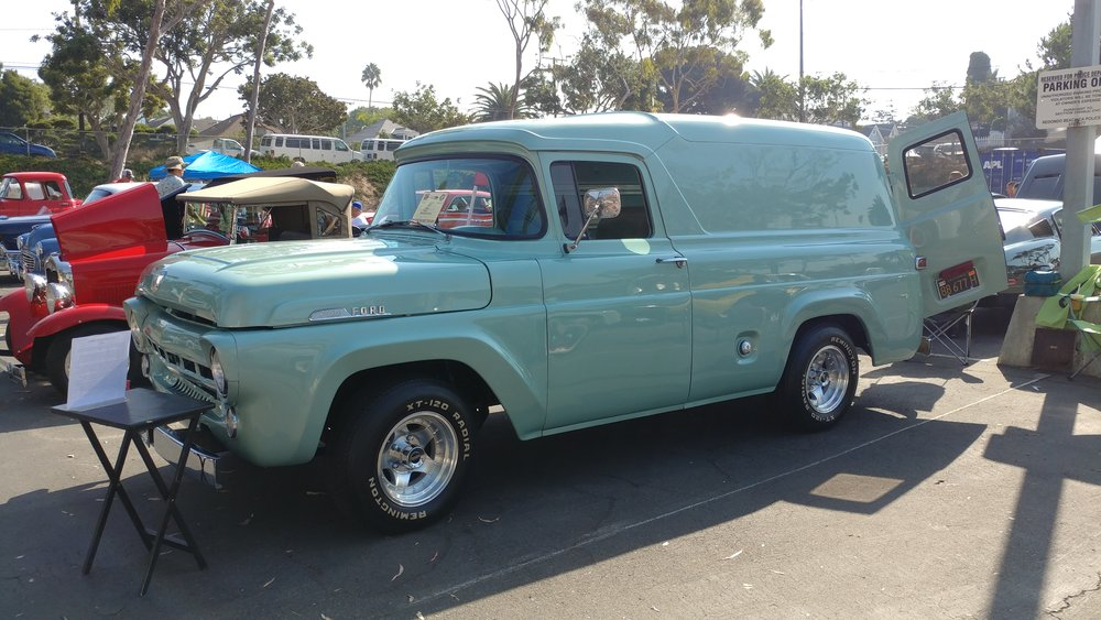 "1957 Ford Panel Truck - ""Our truck was purchased in derelict condition, and the vision for her was to be used in a side meat business that my Dad owned. We were so little when he purchased her that we were able to stand up in the back of the van and play. Thus she became our playhouse. He restored her to a good condition where she'd be presentable to customers. When he took her away on business we were a bit disturbed. After he passed we had her re-painted, the interior done, and she's beautiful."""