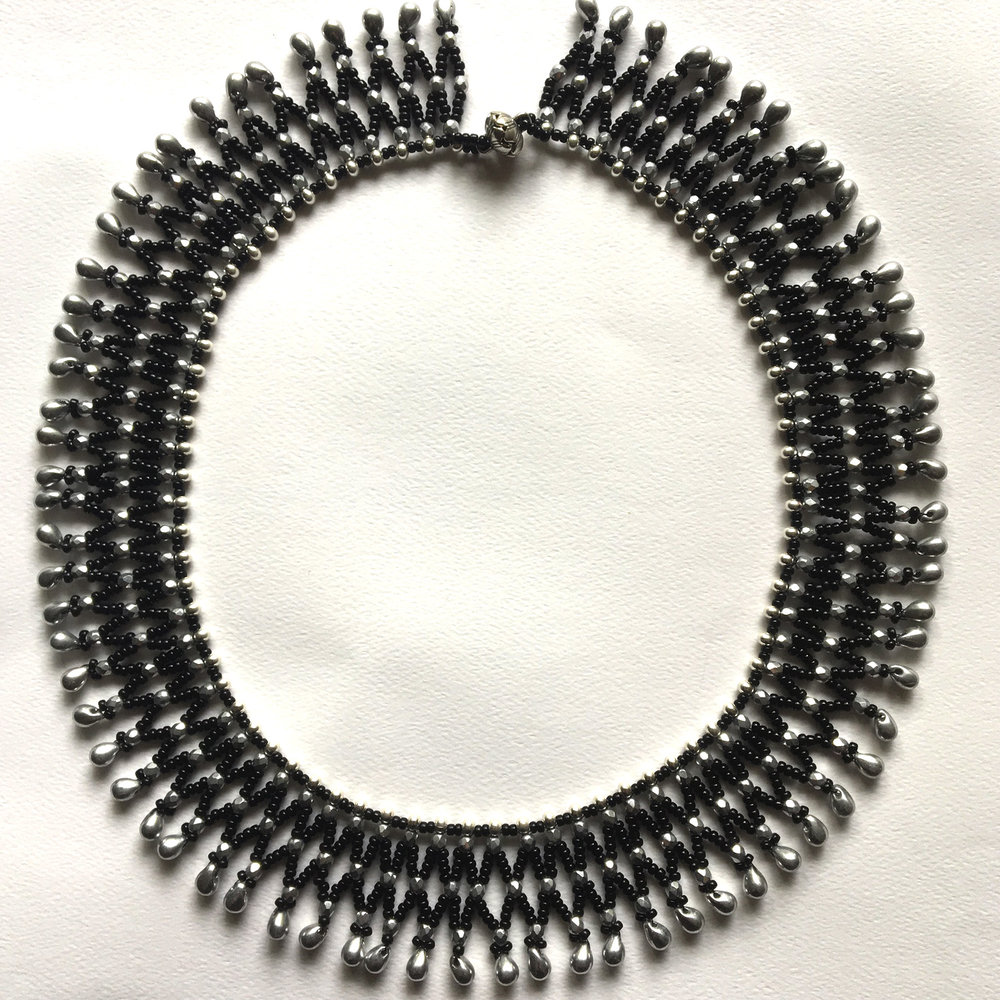 - Black and silver netted necklace