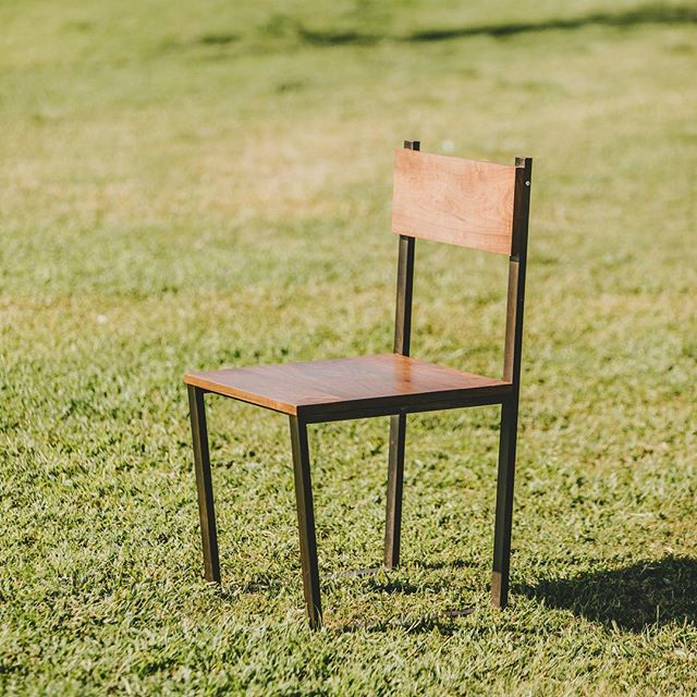 Dining chair in black steel and walnut. Available with wood or leather backs in store and online. #furniture #sandiego