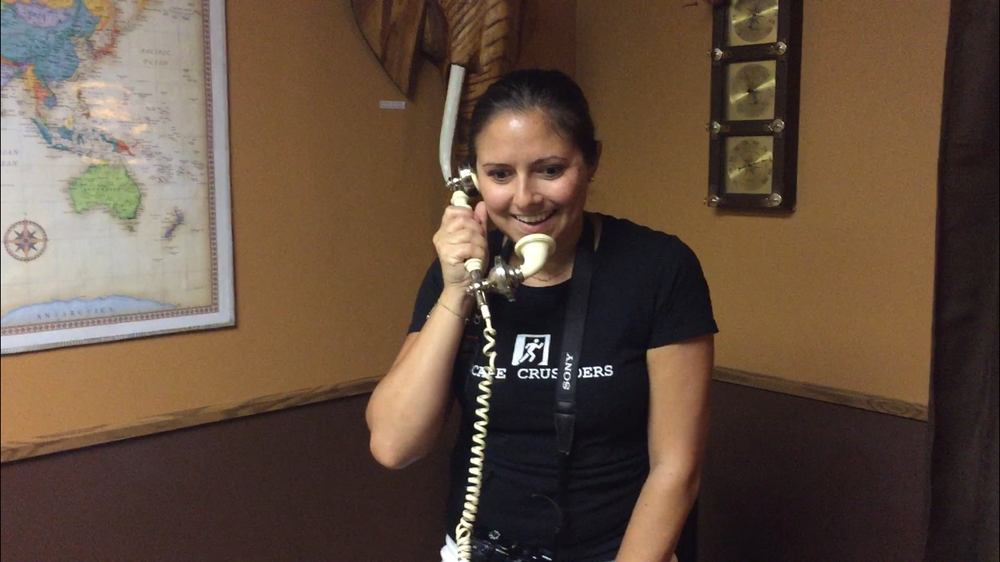 Mel making secret calls in  Daytona Escape Room  Check out our Review for  Daytona Escape Room HERE