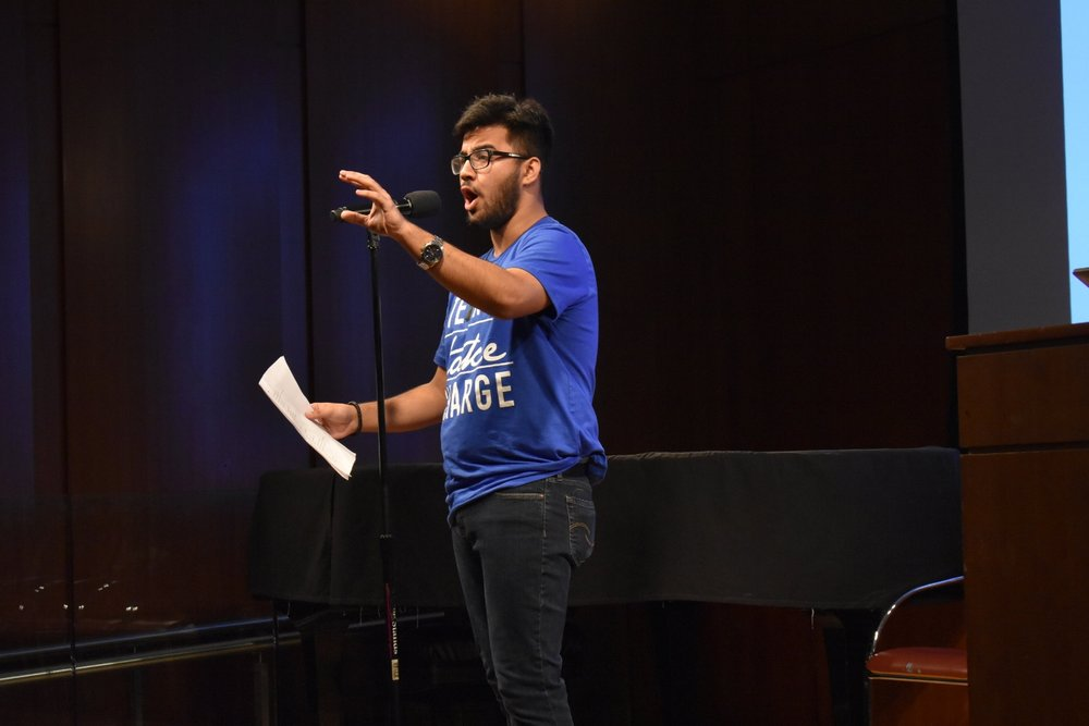 Muhammad Deen performed a spoken word piece about how schools just a few bus stops apart offer students vastly different opportunities.  Photo by Julian Giordano