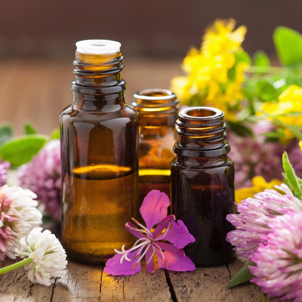 3-essential-oils-and-flowers-on-wood.jpg