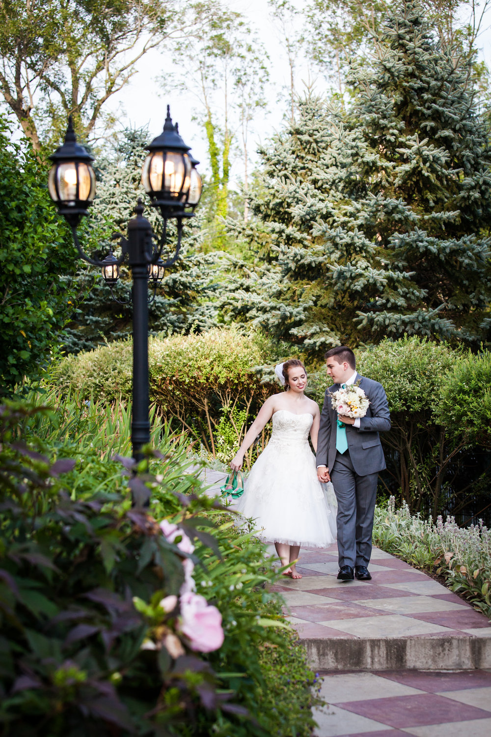 Bride and groom walking at Round Hill House for the contact page of NYC wedding photojournalist, Kelly Williams