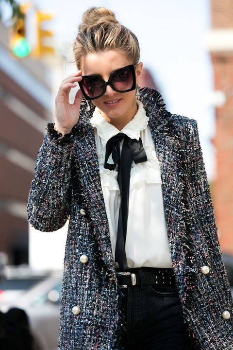 Olga Slesarenco was also captured by Cosmopolitan's street-style photographer. She opted for an ultra-feminine look topped with fall's favorite fabric – tweed.