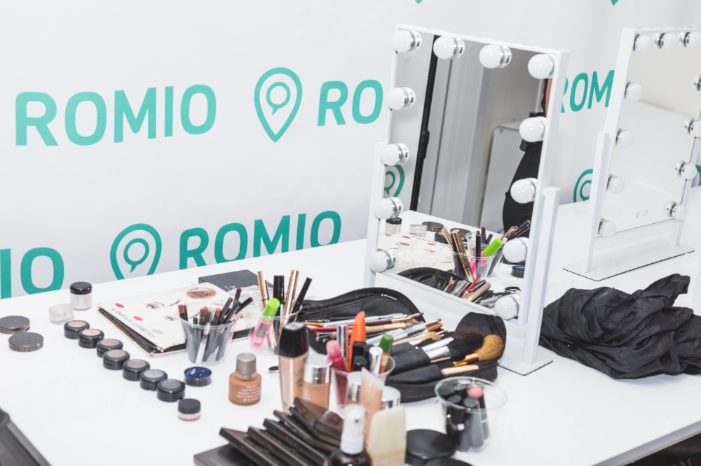 Romio Makeup Artist Lorin Cole sets up her beauty station before the guests arrive.