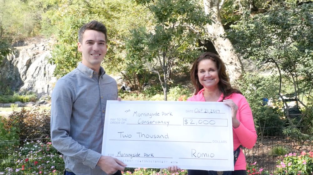 Business Development Director, Fillip Hord, presents Morningside Park Conservancy Ambassador, Julia Boland, a $2,000 donation. Julia's also a Romio Real Estate Expert. Check out the platform later this fall for Julia's recommended services in NYC!