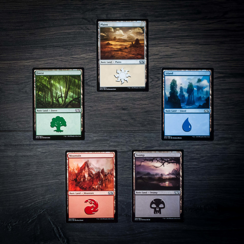The five basic land cards: Plains, Island, Swamp, Mountain, and Forest