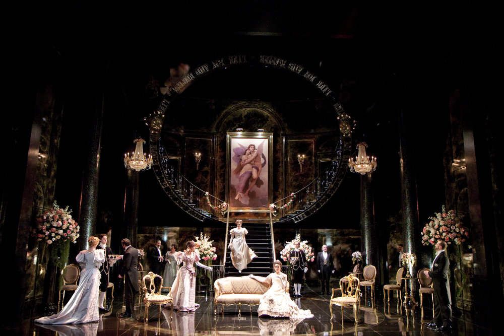 Descending the staircase, Opening scene of  An Ideal Husband.  Shakespeare Theatre Company