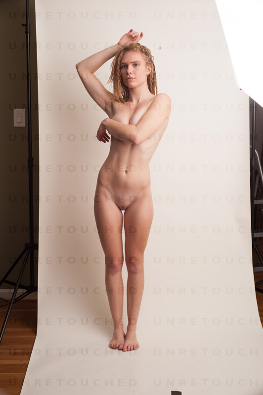 On models with skinny legs you can exploit the fact that there is still a gap even if their feet are touching. In this photo the legs aren't curvy enough and one of the knees needs to be bent and pointing inward or outward for this pose to work.
