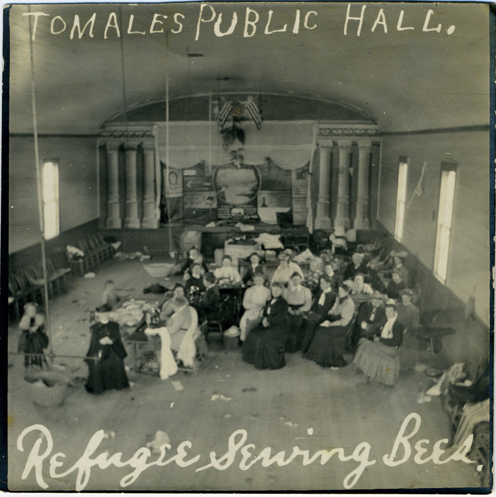 Sewing Bee at Tomales Town Hall to benefit Earthquake Refugees, 1906. Photo: Ella Jorgensen; courtesy Tomales Regional History Center.