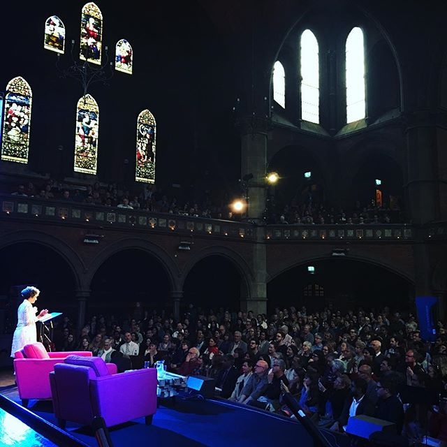 "Arundhati Roy on stage reading from her book ""The Ministry of Utmost Happiness"" to a full capacity audience at The Union Chapel ... The Power of Words!  #ArundhatiRoy #PenguinBook #GuardianLive #UnionChapel #Video #Projection #AsDescribed"