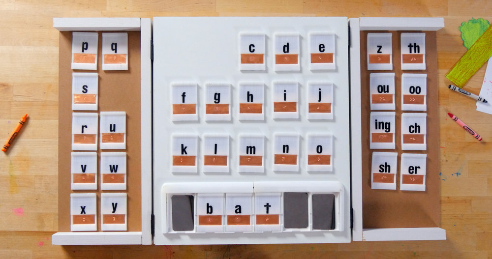 The Read Read with letter tiles, displaying the word 'bat' on the grid.