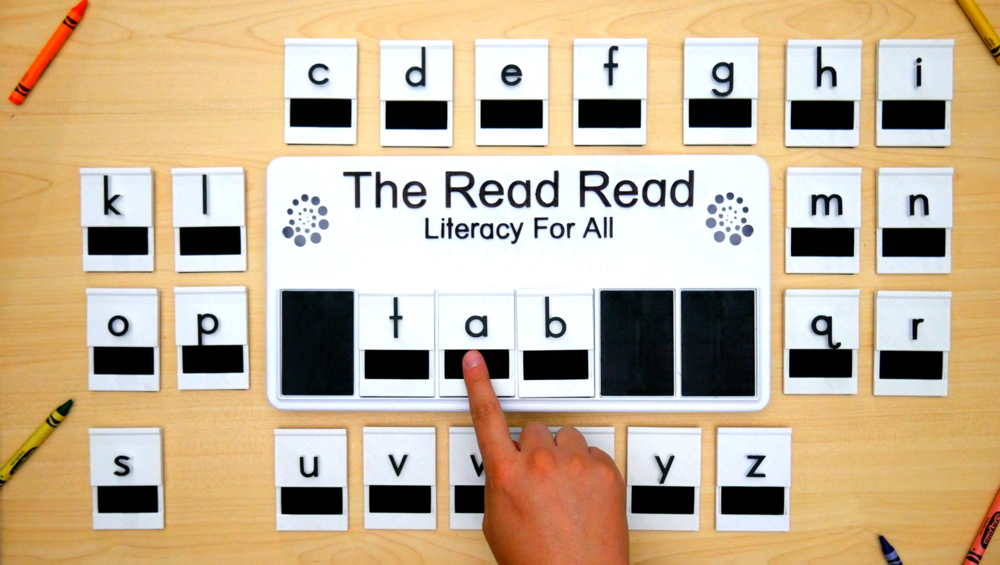 User touching braille on the word 'tab' on The Read Read™